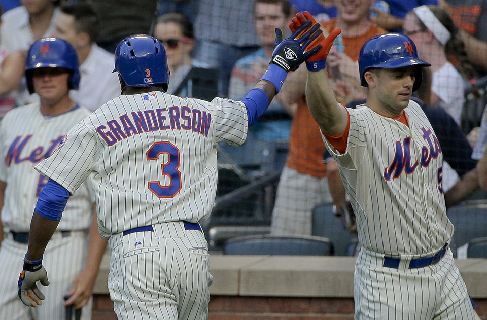 Photo - New York Mets right fielder Curtis Granderson (3) is greeted by New York Mets' David Wright (5) after hitting a solo home run against the Atlanta Braves during the first inning of a baseball game, Tuesday, July 8, 2014, in New York. (AP Photo/Julie Jacobson)