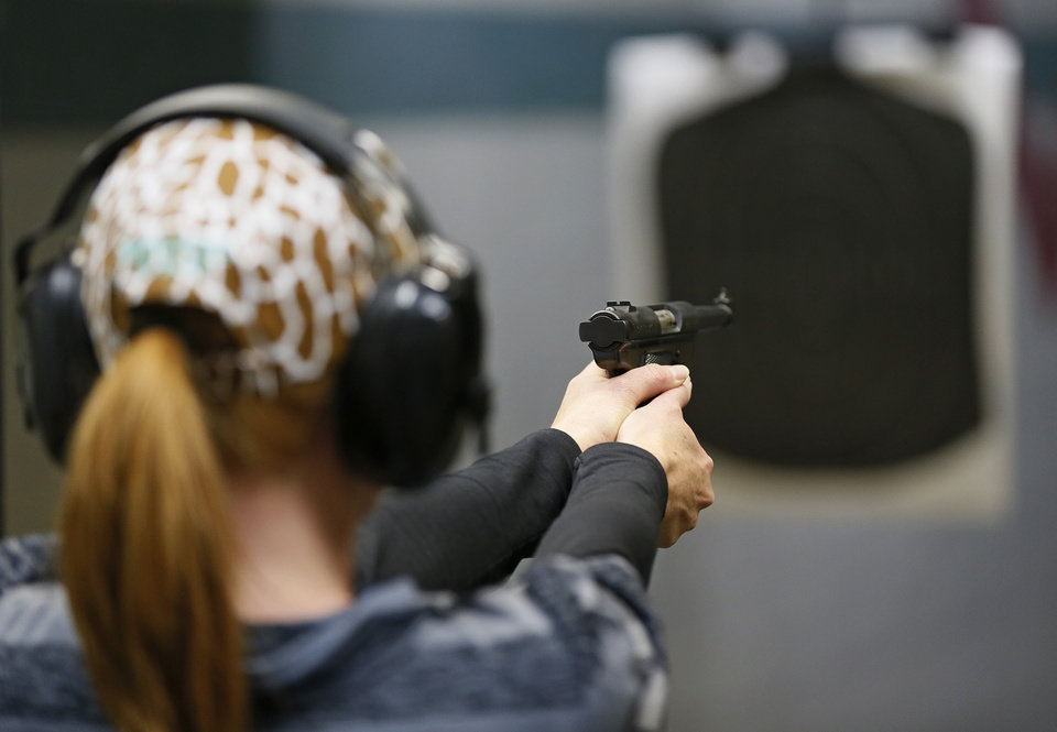 Tracy Lewis takes aim on a gun range during a concealed-carry class at H&H Gun Range and Shooting Sports Complex in Oklahoma City, Wednesday, Jan. 23, 2013. Photo by Nate Billings, The Oklahoman