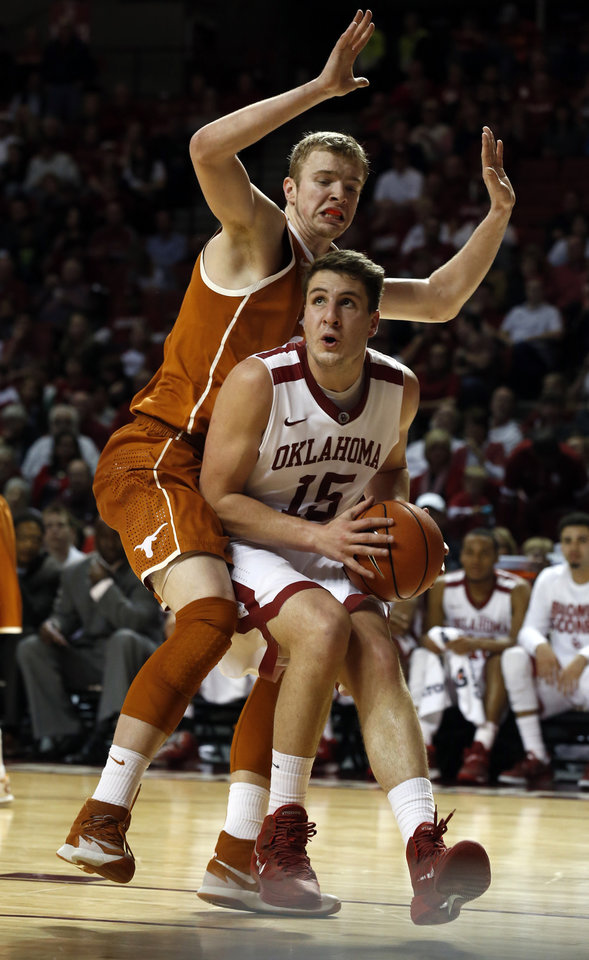 Photo - Oklahoma Sooner Tyler Neal (15) looks to score under the basket guarded by Texas Longhorn's Connor Lammert (21) in the second half as the University of Oklahoma Sooners (OU) men defeat the Texas Longhorns (TU) 77-65 in NCAA, college basketball at The Lloyd Noble Center on Saturday, March 1, 2014  in Norman, Okla. Photo by Steve Sisney, The Oklahoman