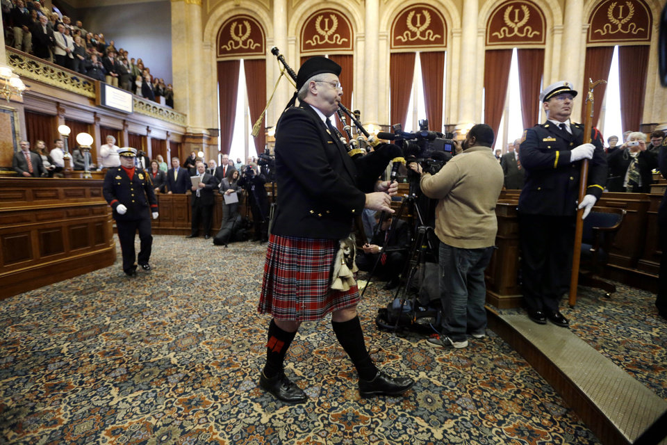 Burlington Deputy Fire Chief Gene Wilkerson plays the bagpipes on the floor of the Iowa House during the opening day of the Iowa Legislature, Monday, Jan. 14, 2013, at the Statehouse in Des Moines, Iowa. (AP Photo/Charlie Neibergall)