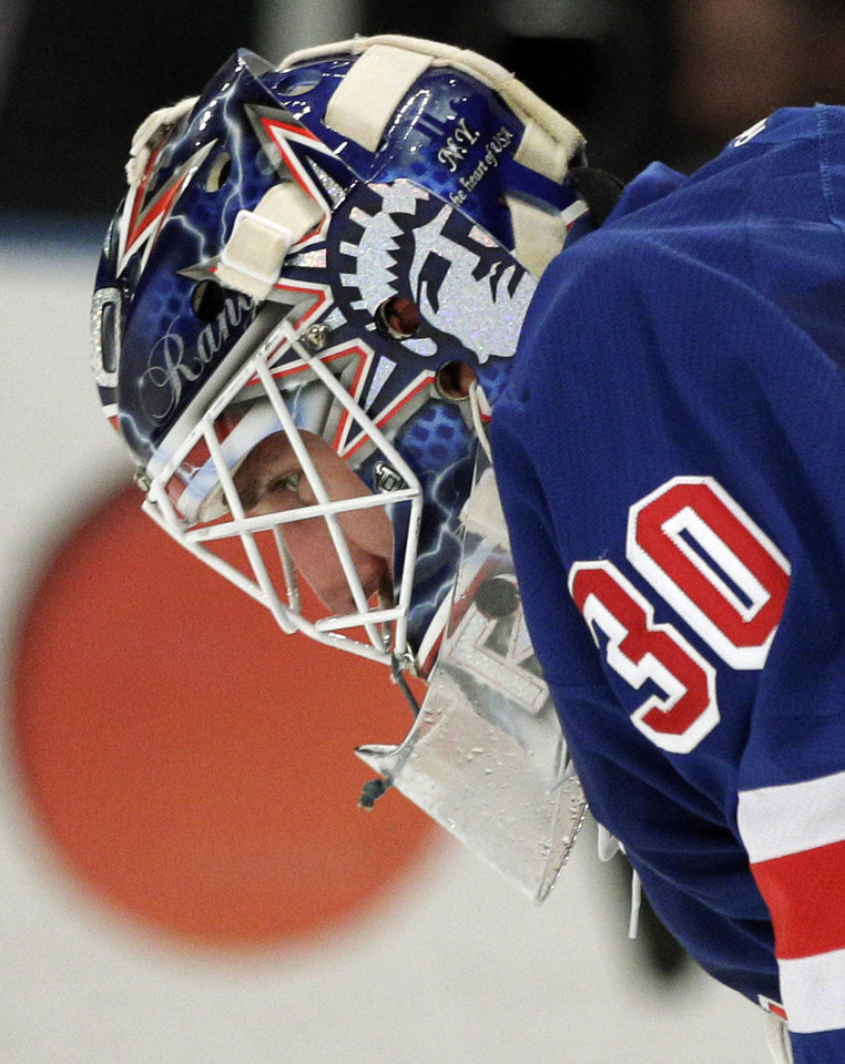Photo -   New York Rangers goalie Henrik Lundqvist, of Sweden, pauses during the first period of Game 5 of an NHL hockey Stanley Cup Eastern Conference final playoff series against the New Jersey Devils, Wednesday, May 23, 2012, in New York. (AP Photo/Frank Franklin II)