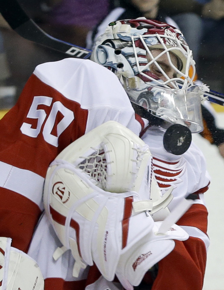 Detroit Red Wings goalie Jonas Gustavsson (50), of Sweden, blocks a shot by the Nashville Predators in the second period of an NHL hockey game Tuesday, Feb. 19, 2013, in Nashville, Tenn. (AP Photo/Mark Humphrey)