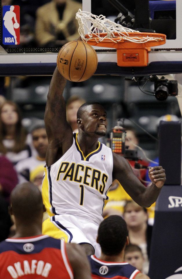 Indiana Pacers guard Lance Stephenson (1) dunks in front of Washington Wizards' Garrett Temple, right, and Emeka Okafor during the first half of an NBA basketball game, Wednesday, Jan. 2, 2013, in Indianapolis. (AP Photo/AJ Mast)