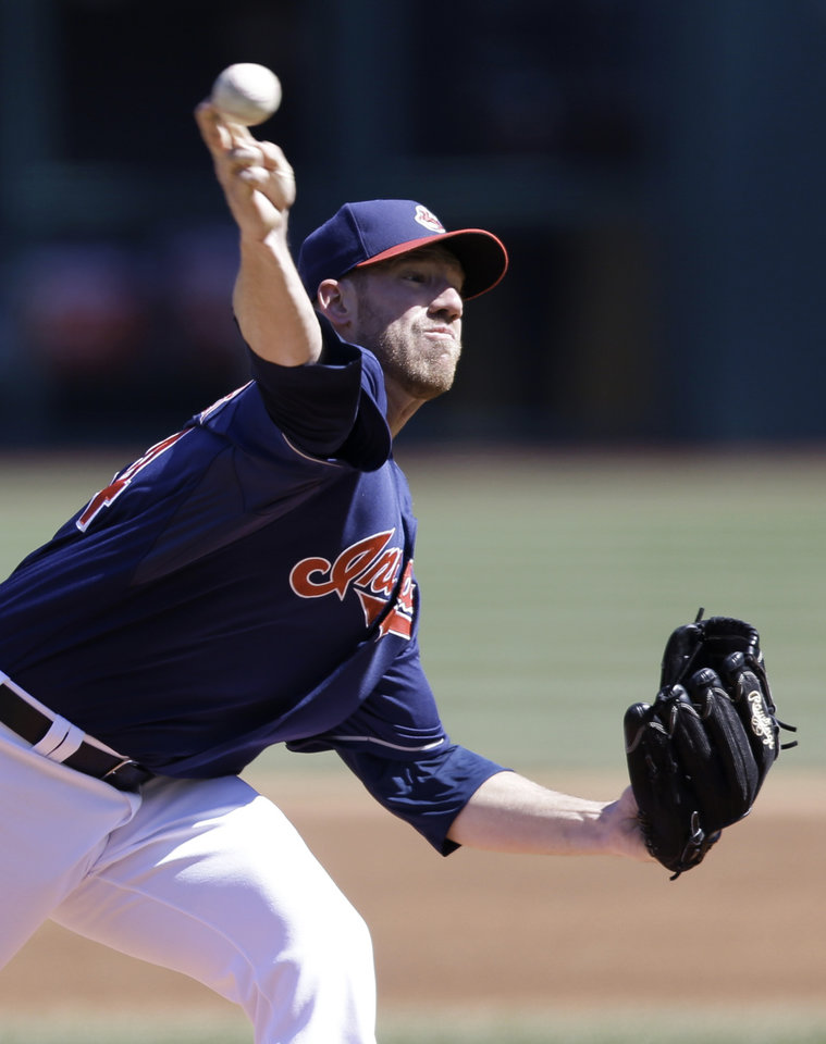 Photo - Cleveland Indians starting pitcher Zach McAllister delivers in the first inning in the first baseball game of a doubleheader against the San Diego Padres, Wednesday, April 9, 2014, in Cleveland. (AP Photo/Tony Dejak)