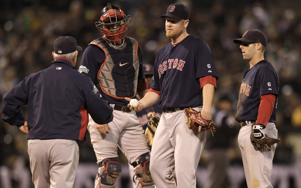 Photo -   Boston Red Sox pitcher Aaron Cook, second from right, hands the ball to manager Bobby Valentine as he is removed from the baseball game against the Oakland Athletics in the third inning Friday, Aug. 31, 2012, in Oakland, Calif. (AP Photo/Ben Margot)