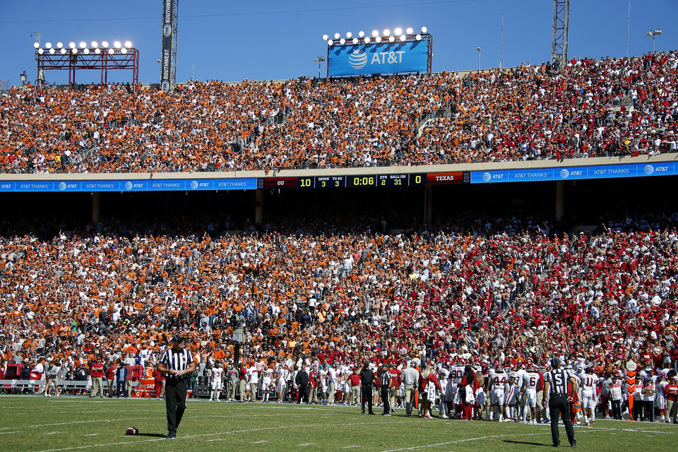 Photo - Oklahoma and Texas fans watch the Red River Showdown college football game between the University of Oklahoma Sooners (OU) and the Texas Longhorns (UT) at Cotton Bowl Stadium in Dallas, Saturday, Oct. 12, 2019. Oklahoma won 34-27. [Bryan Terry/The Oklahoman]