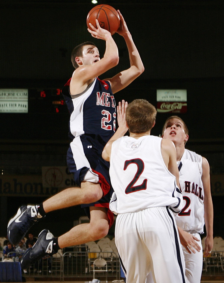 Photo - Metro Christian's Todd Canady (22) shoots over A.Z Moyer (2) and Stephen Rouse (12) of Cascia Hall during the 3A boys semifinal game between Metro Christian and Cascia Hall in the Oklahoma High School Basketball Championships at State Fair Arena in Oklahoma City, Friday, March 13, 2009. PHOTO BY NATE BILLINGS, THE OKLAHOMAN