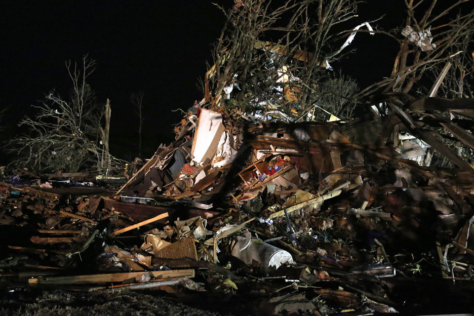 Photo - Debris is scattered in what was a mobile home park where a tornado struck near Dale, Okla., Sunday, May 19, 2013. (AP Photo Sue Ogrocki)