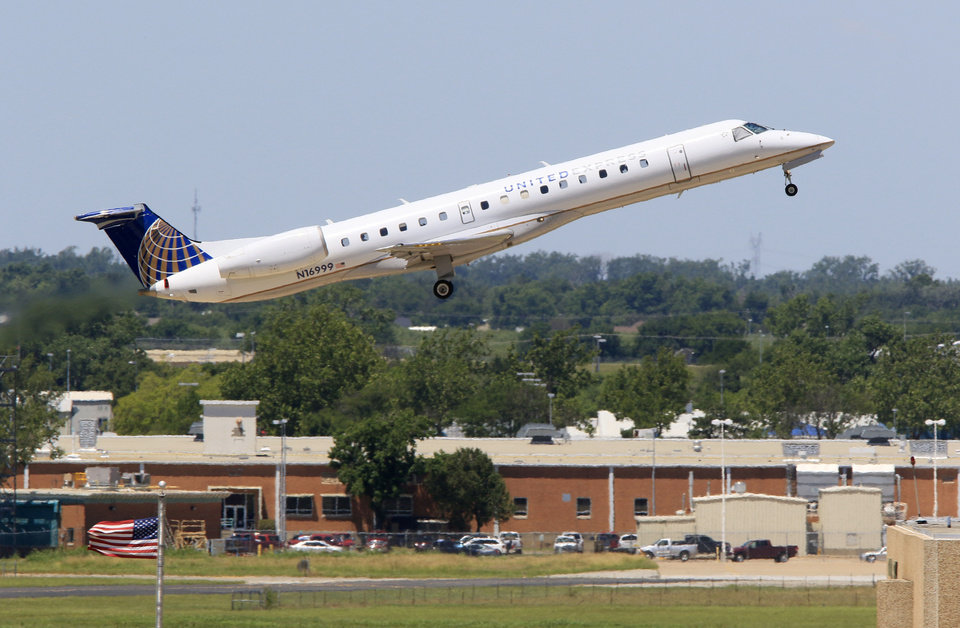 Photo - In this file photo, a passenger jet takes off from Will Rogers World Airport in Oklahoma City. Photo by Paul Hellstern, The Oklahoman
