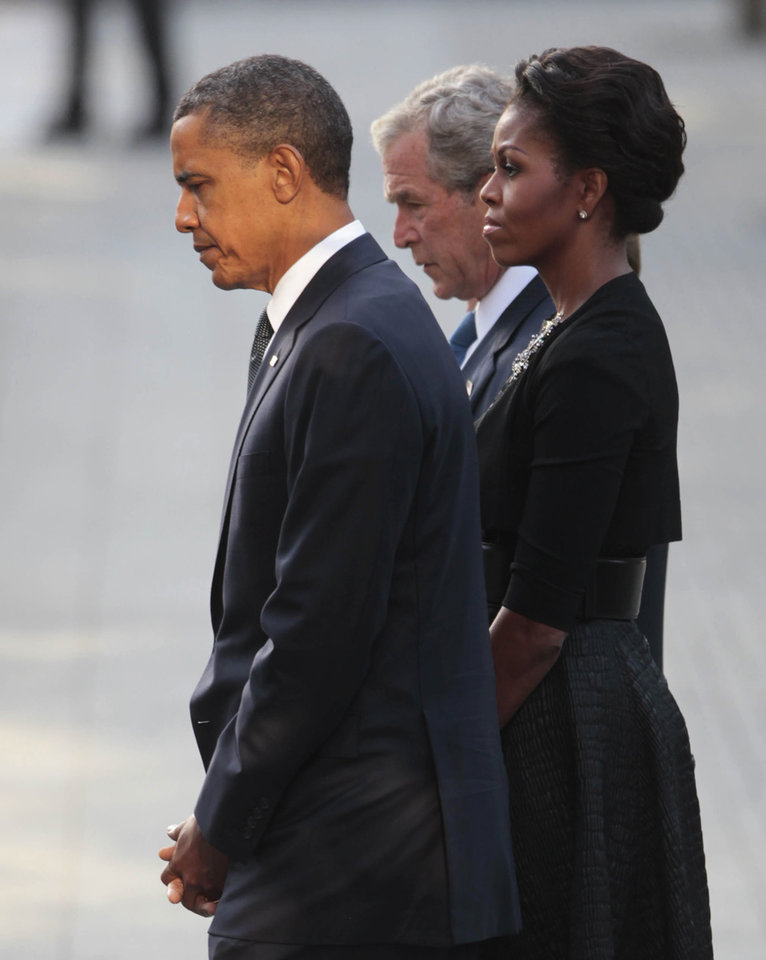 President Barack Obama and first lady Michelle Obama and former President George W. Bush visit North Memorial Pond at the National Sept. 11th Memorial Sunday, Sept., 11, 2011 in New York. (AP Photo/Pablo Martinez Monsivais)