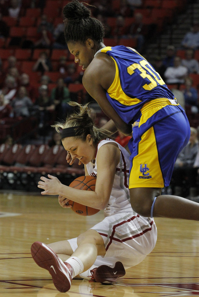 Oklahoma's Nicole Kornet (1) and Jamila Williams (30) fight for a loose ball as the University of Oklahoma Sooners (OU) play the Riverside Highlanders in NCAA, women's college basketball at The Lloyd Noble Center on Thursday, Dec. 20, 2012  in Norman, Okla. Photo by Steve Sisney, The Oklahoman