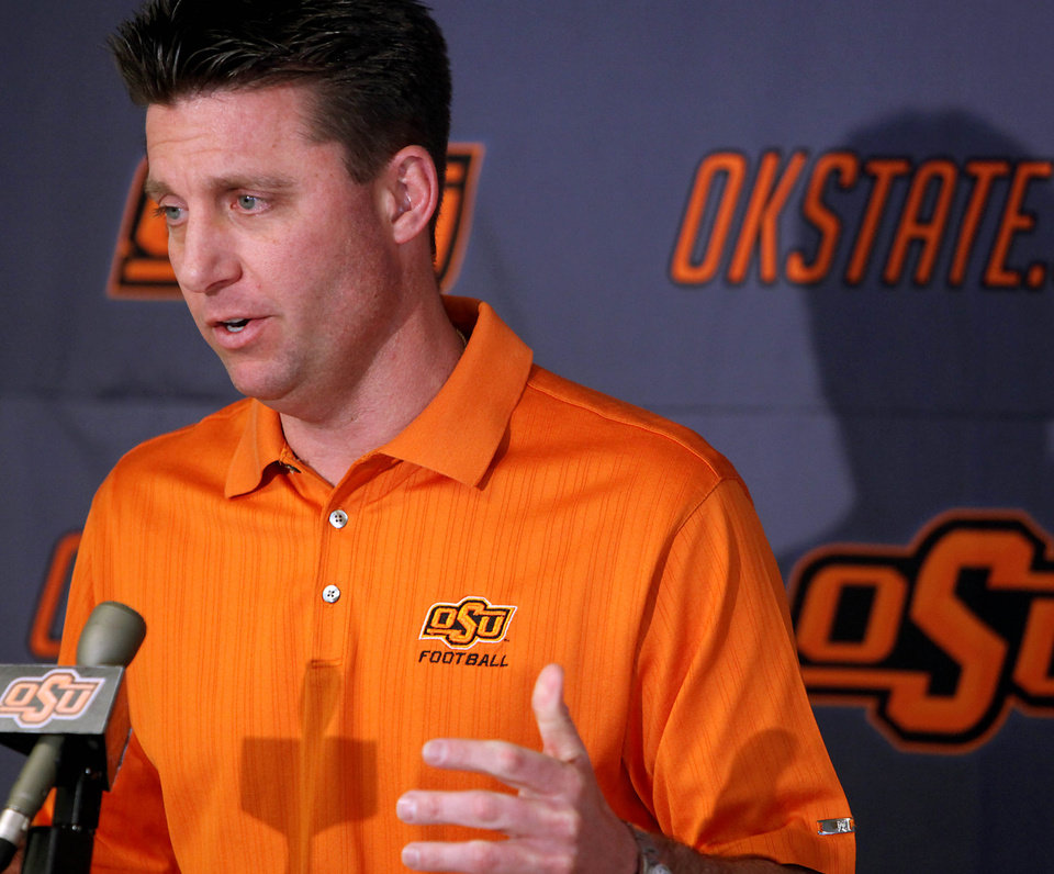 Photo - Oklahoma State head coach Mike Gundy speaks to the media during a press conference at Boone Pickens Stadium in Stillwater, Okla., on Wednesday, Feb. 4, 2009. By John Clanton, The Oklahoman