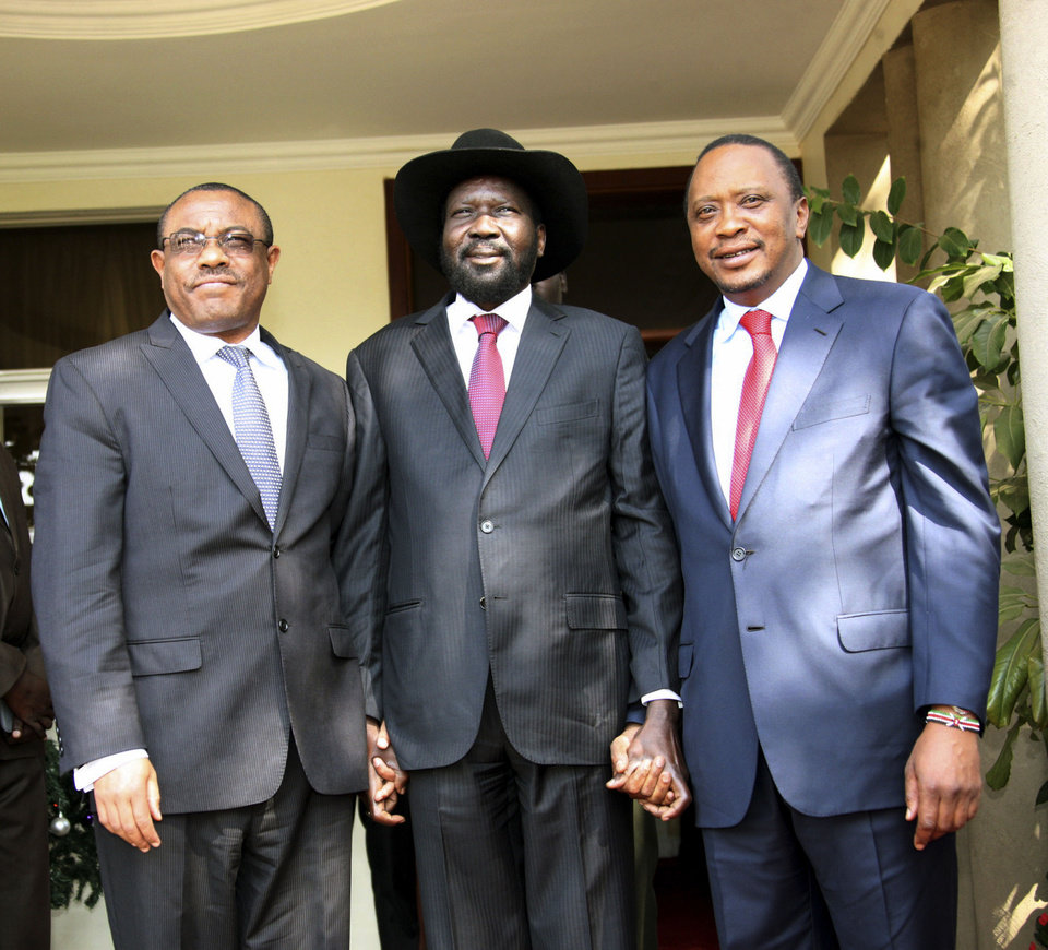 Photo - In this photo released by the Kenyan Presidential Press Service, Ethiopian Prime Minister Hailemariam Desalegn, left, South Sudanese President Salva Kiir, center, and Kenyan President Uhuru Kenyatta, right, pose for a photos before their meeting at State House in Juba, South Sudan, Thursday, Dec. 26, 2013. The leaders of Kenya and Ethiopia arrived in South Sudan on Thursday to try and mediate between the country's president and the political rivals he accuses of attempting a coup that the government insists sparked violence threatening to destroy the world's newest country. (AP Photo/Kenyan Presidential Press Service)