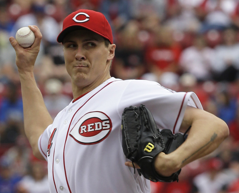 Photo - Cincinnati Reds starting pitcher Homer Bailey throws against the Chicago Cubs in the first inning of the MLB National League baseball game, Saturday, May 25, 2013, in Cincinnati. (AP Photo/Al Behrman)