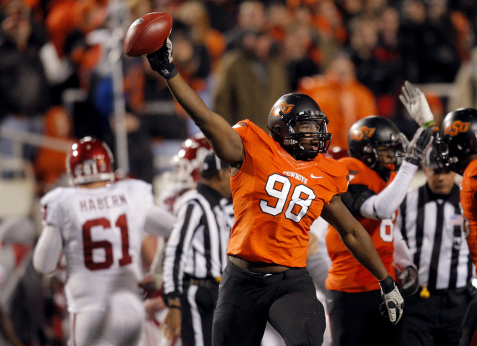 Oklahoma State's Davidell Collins (98) celebrates a fumble recovery during the Bedlam college football game between the Oklahoma State University Cowboys (OSU) and the University of Oklahoma Sooners (OU) at Boone Pickens Stadium in Stillwater, Okla., Saturday, Dec. 3, 2011. Photo by Sarah Phipps, The Oklahoman