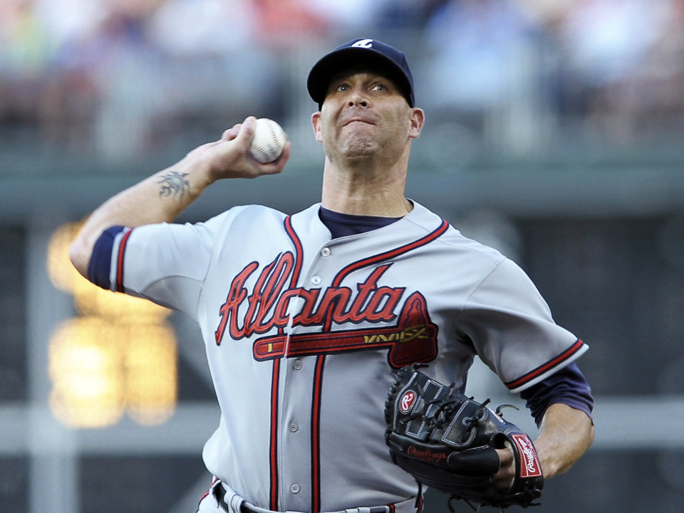 Photo - Atlanta Braves' Tim Hudson throws a pitch in the first inning of a baseball game against the Philadelphia Phillies on Saturday, July 6, 2013, in Philadelphia. (AP Photo/Michael Perez)