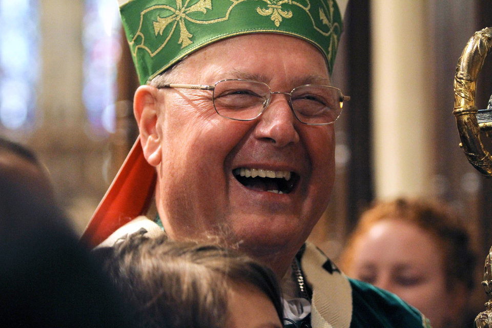 Photo - Cardinal Timothy Dolan, laughs following Mass, Sunday, Sept. 22, 2013, at St. Patrick's Cathedral in New York. Pope Francis' said Sept. 19, that pastors should focus less on divisive social issues and should emphasize compassion over condemnation. Dolan told reporters that Francis,