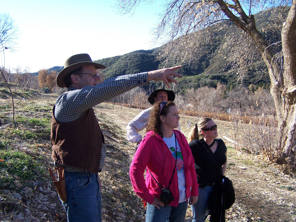 Photo - Kevin Hauser, founder of Kuffel Creek Apple Nursery in California, talks with Sharon Allen of Piedmont during his course on apple culture at Riley's Farm, a ranch in southern California. Photo provided