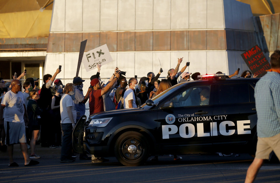 Photo - Protesters chant near a spot a person is arrested during a protest near the intersection of 23rd and Classen in Oklahoma City, Saturday, May 30, 2020. The protest was in response to the death of George Floyd. [Sarah Phipps/The Oklahoman]