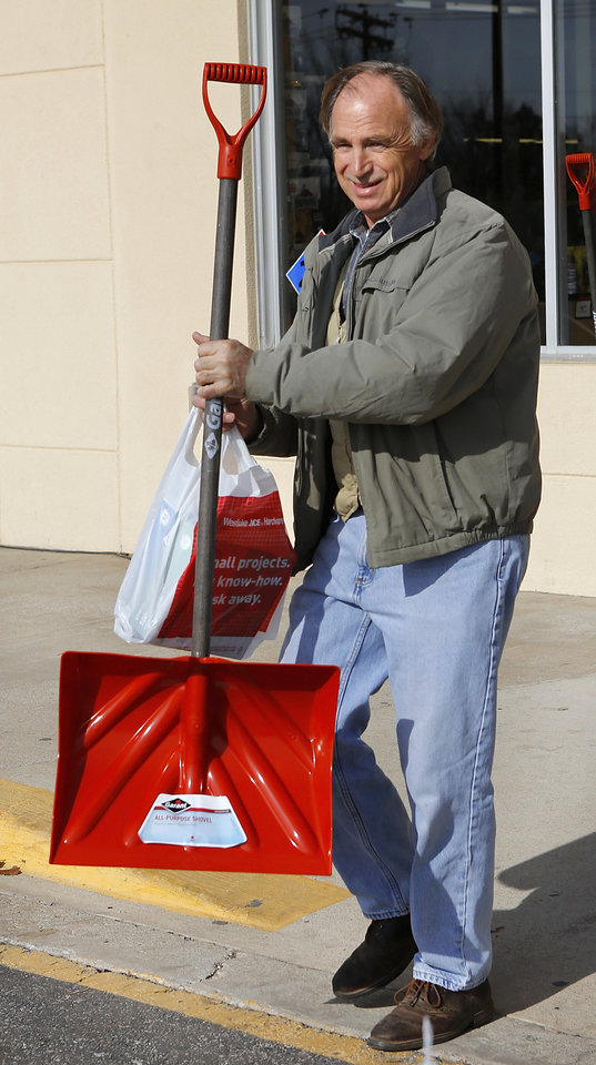 Steve Dodson, Oklahoma City, carries a newly-purchased snow shovel to his car. The threat of a severe winter storm, expected to arrive in Oklahoma City on Christmas Day,  ushered a throng of customers into the Westlake Hardware Store, 1509 W Britton Road,  to purchase snow shovels, ice melt, snow scrapers and tubes filled with sand on Monday, Dec. 24, 2012, Photo by Jim Beckel, The Oklahoman
