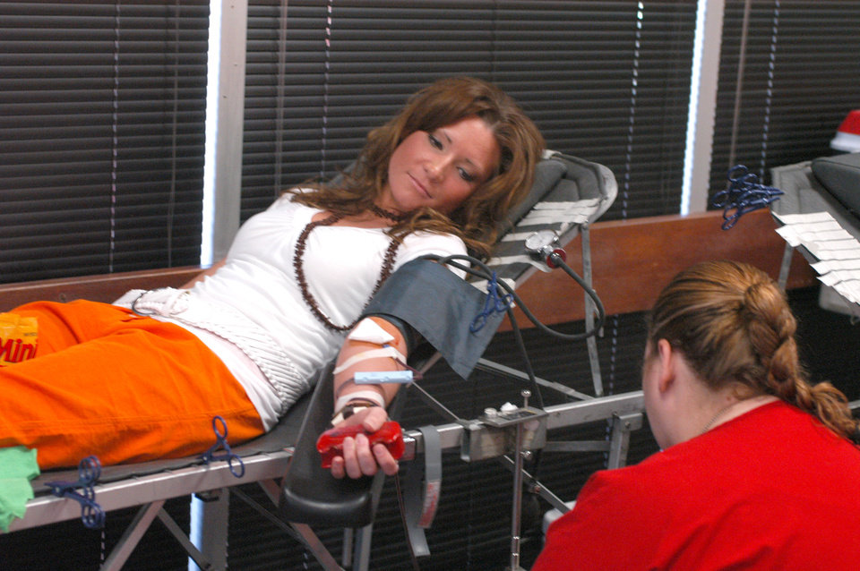 Rose State College student Lara Singletary gives blood during the Oklahoma Blood Institute's campus blood drive. The RSC Student Activities Office co-sponsors the blood drive each semester.<br/><b>Community Photo By:</b> Steve Reeves<br/><b>Submitted By:</b> natalie,
