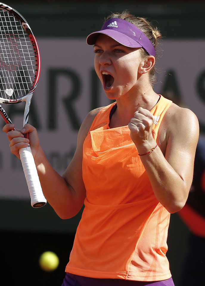 Photo - Romania's Simona Halep reacts as she wins the second set against Russia's Maria Sharapova during their final match of  the French Open tennis tournament at the Roland Garros stadium, in Paris, France, Saturday, June 7, 2014. (AP Photo/Michel Euler)