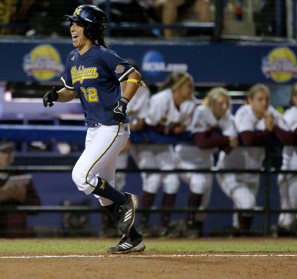 Michigan's Sierra Romero runs past the Arizona State dugout on her way home after hitting a two-run home run in the third inning of a Women's College World Series softball game at ASA Hall of Fame Stadium in Oklahoma City, Sunday, June, 2, 2013. Photo by Bryan Terry, The Oklahoman