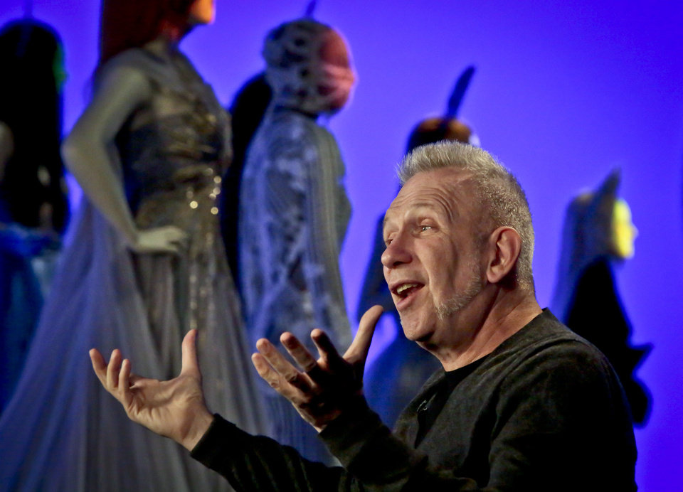 Photo - Fashion designer Jean Paul Gaultier speaks during an interview about the installation of his Brooklyn Museum's