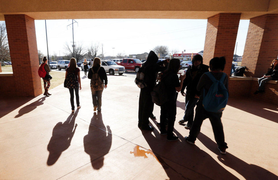 Photo - Students leave at the end of the school day from Moore High School on Tuesday.  PHOTOS BY STEVE SISNEY, THE OKLAHOMAN