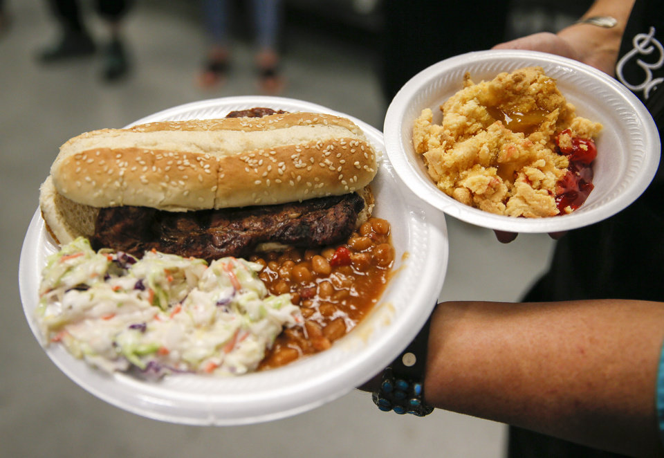 Photo -  Rib-eye steak sandwich, beans, coleslaw and cobbler were served by the Oklahoma Cattlemen's Association and the Oklahoma Beef Council as part of the Turning the Table on Hunger campaign for the Homeless Alliance. [Photo by Nate Billings, The Oklahoman]