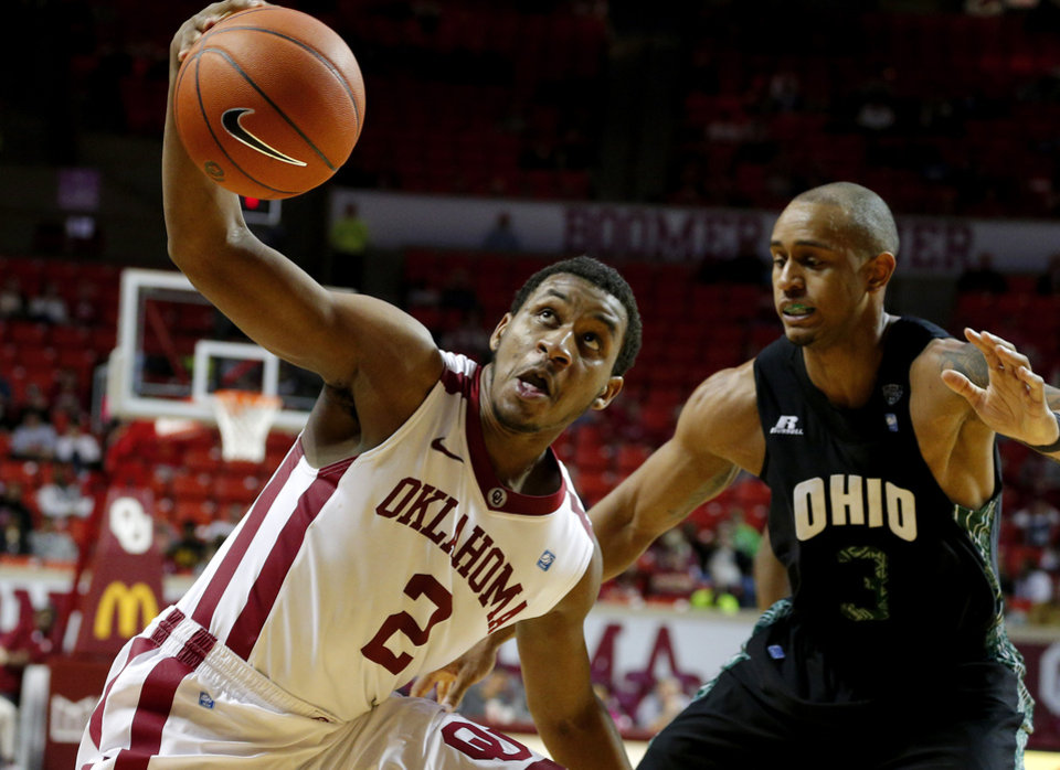 Photo - Oklahoma's Steven Pledger (2) tries to control the ball next to Ohio's Walter Offutt (3) during a NCAA college basketball game between the University of Oklahoma (OU) and Ohio at the Lloyd Noble Center in Norman, Saturday, Dec. 29, 2012. Oklahoma won 74-63. Photo by Bryan Terry, The Oklahoman