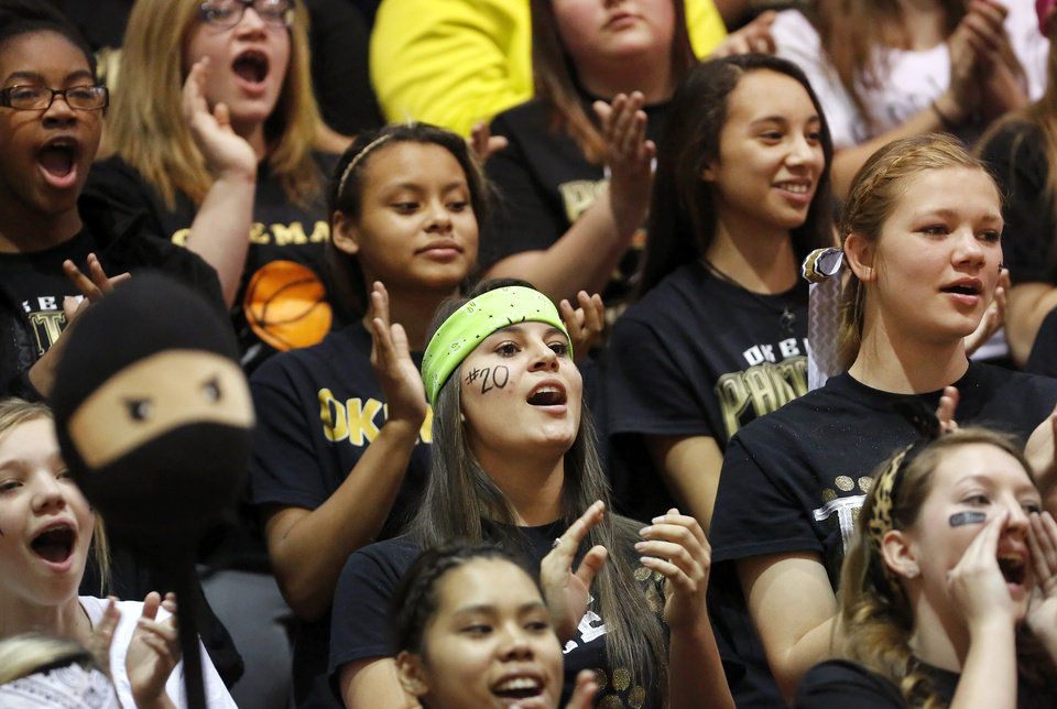 Photo - Okemah High School students cheer for their team during the Class 3A boys basketball quarterfinal game between Okemah Panthers and Heritage Hall Chargers at Carl Albert High School on Thursday afternoon, Mar. 13, 2014. Photo by Jim Beckel, The Oklahoman