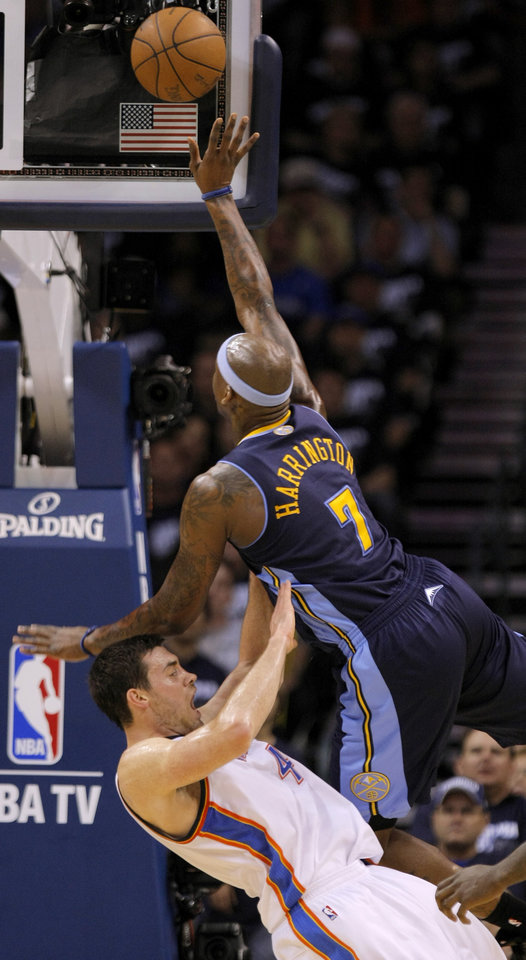 Denver's Al Harrington (7) is called for a foul as he hits Oklahoma City's Nick Collison (4) during the NBA basketball game between the Denver Nuggets and the Oklahoma City Thunder in the first round of the NBA playoffs at the Oklahoma City Arena, Wednesday, April 27, 2011. Photo by Bryan Terry, The Oklahoman