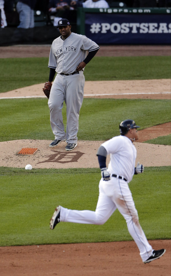 Photo -   New York Yankees' CC Sabathia watches after Detroit Tigers' Miguel Cabrera hits a two run home run in the fourth during Game 4 of the American League championship series Thursday, Oct. 18, 2012, in Detroit. (AP Photo/Charlie Riedel)
