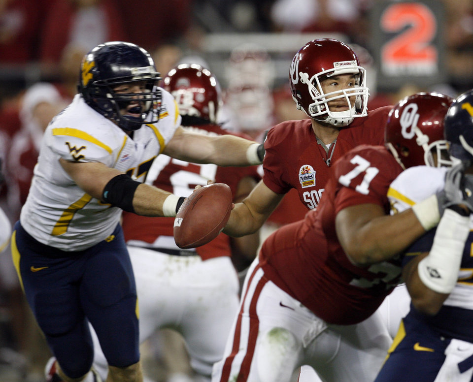 Photo - Reed Williams knocks the ball from the hands of Sam 