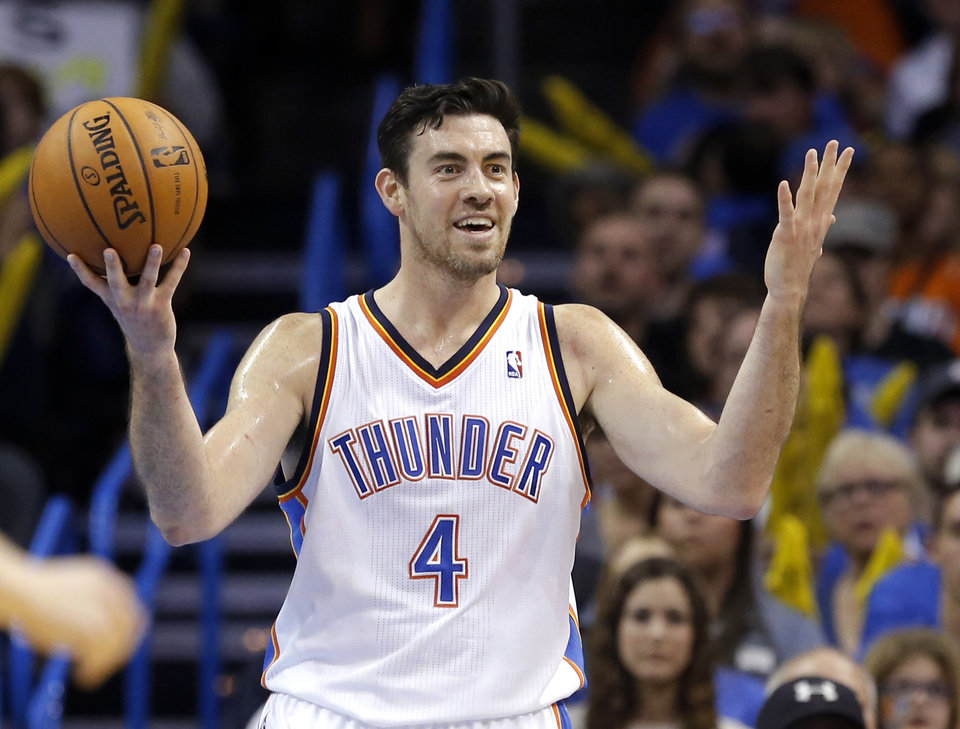 Photo - Oklahoma City's Nick Collison (4) reacts to a call during the NBA game between the Oklahoma City Thunder and the Sacramento Kings at the Chesapeake Energy Arena, Sunday, Jan. 19, 2014.  Photo by Sarah Phipps, The Oklahoman