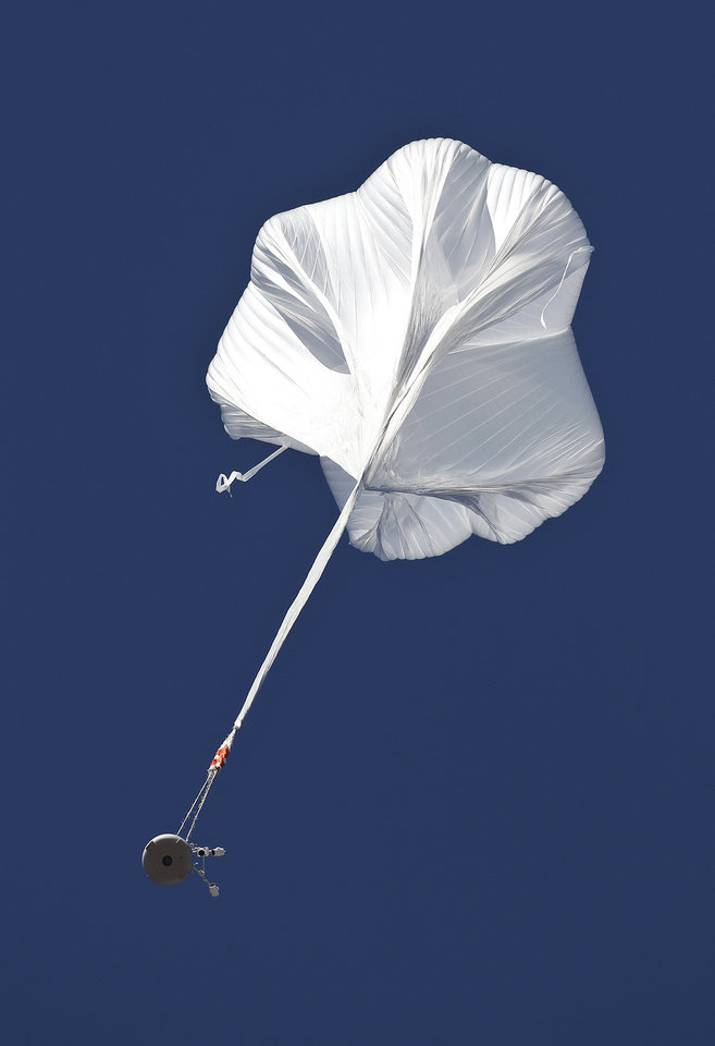 Photo -   The capsule and attached helium balloon carrying Felix Baumgartner lifts off as he attempts to break the speed of sound with his own body by jumping from a space capsule lifted by a helium balloon, Sunday, Oct. 14, 2012, in Roswell, N.M. Baumgartner plans to jump from an altitude of 120,000 feet, an altitude chosen to enable him to achieve Mach 1 in free fall, which would deliver scientific data to the aerospace community about human survival from high altitudes.(AP Photo/Ross D. Franklin)