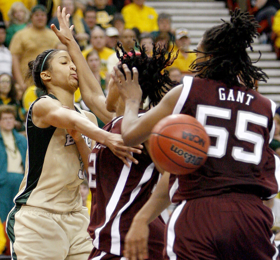 Photo - Baylor's Jessica Morrow passes the ball around Texas A&M's La Toya Micheaux, and Danielle Gant during the championship game of the Big 12 Women's Basketball Championship between Baylor and Texas A&M at the Cox center in Oklahoma City, Sunday, March 15, 2009. PHOTO BY BRYAN TERRY, THE OKLAHOMAN
