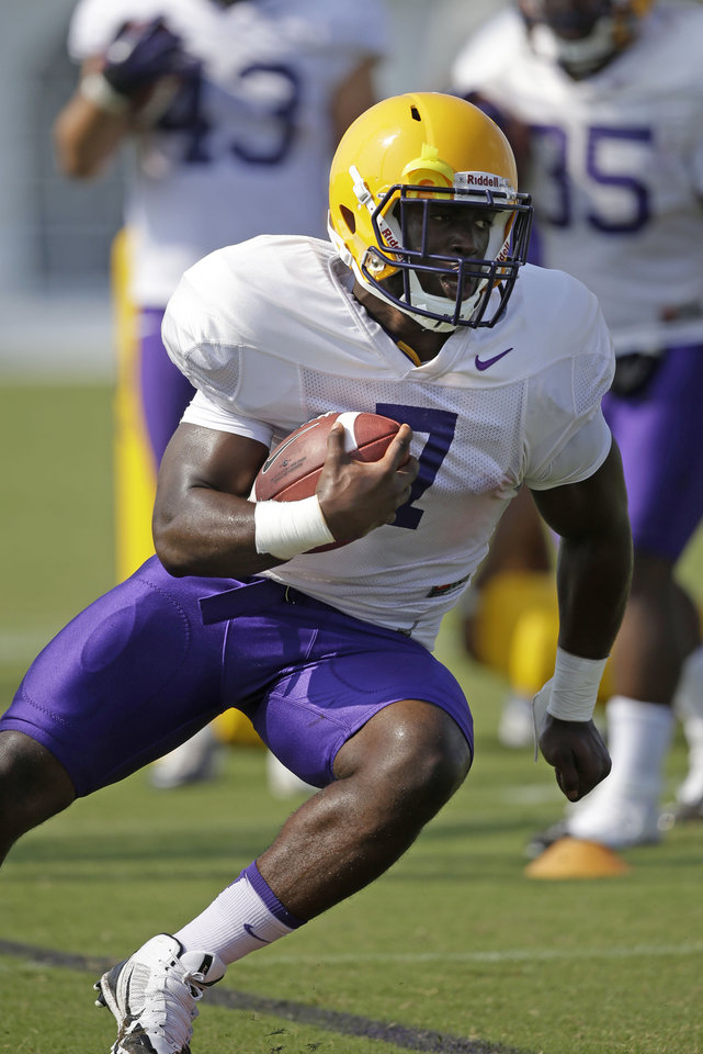 Photo - FILE - In this Aug. 6, 2014, file photo, LSU freshman running back Leonard Fournette (7) runs through drills during an NCAA college football practice in Baton Rouge, La. Fournette headlines another promising group looking to make an immediate impact.  (AP Photo/Gerald Herbert, File)