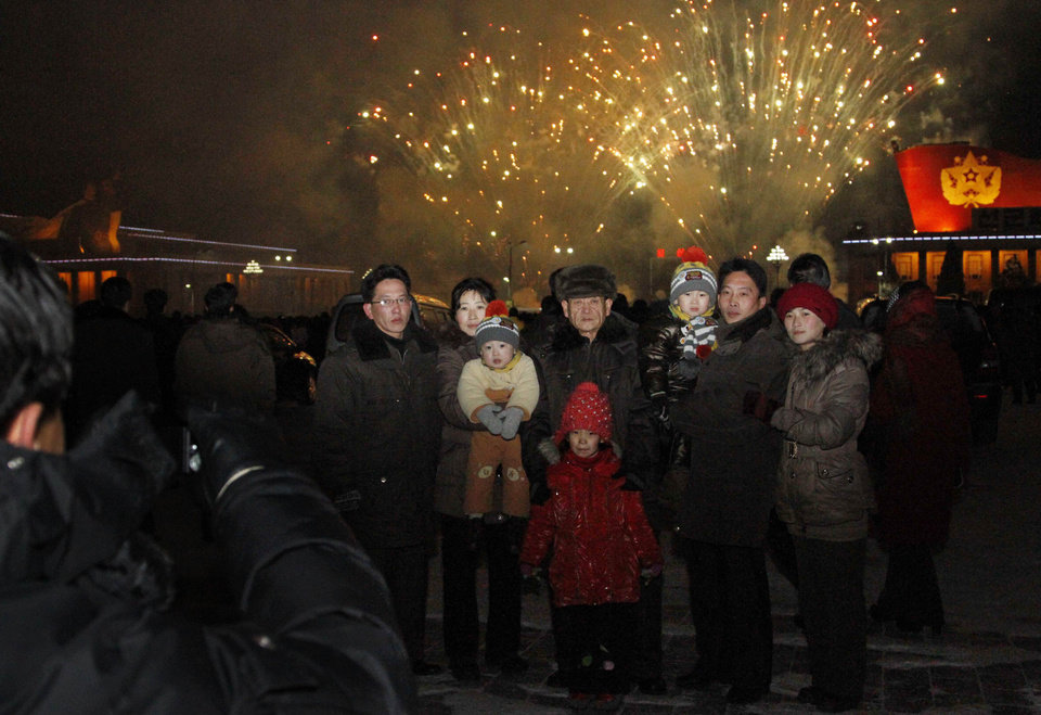 A North Korean family has their photo taken in front of fireworks as they celebrate the new year on Tuesday Jan. 1, 2013. North Koreans celebrated the arrival of the new year, marked as �Juche 102� on North Korean calendars. �Juche� means �self reliance,� the North Korean ideology of independence promoted by North Korean founder Kim Il Sung, and modern-day North Korean calendars start with the year of his birth in 1912. (AP Photo/Kim Kwang Hyon)