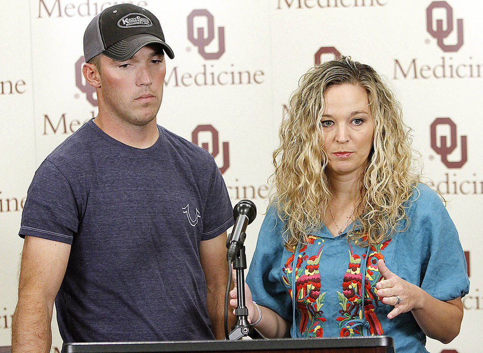 Photo - Levy and Devyn Galmor talk to members of the media during a press conference at Children's Hospital in Oklahoma City, Monday 30, 2012. The Galmor's five week old son Collen, was admitted to Children's Hospital with whooping cough symptoms. Photo By Steve Gooch, The Oklahoman