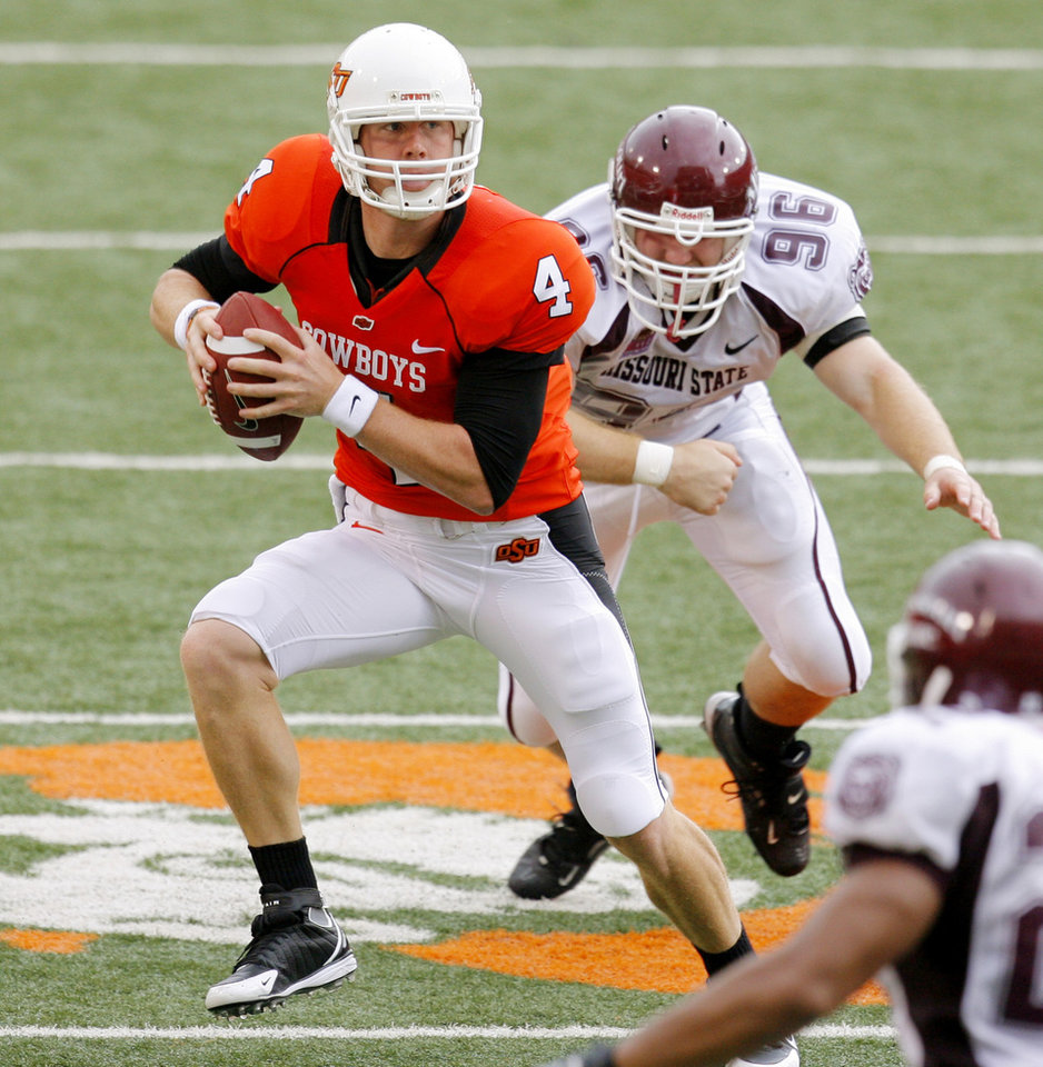 Photo - Brandon Weeden moves out of the pocket because of Grant Detwiler (96) at the Oklahoma State University (OSU) football game against Missouri State University (MSU) Saturday Sept. 13, 2008 at Boone Pickens Stadium in Stillwater, Okla. BY MATT STRASEN, THE OKLAHOMAN.