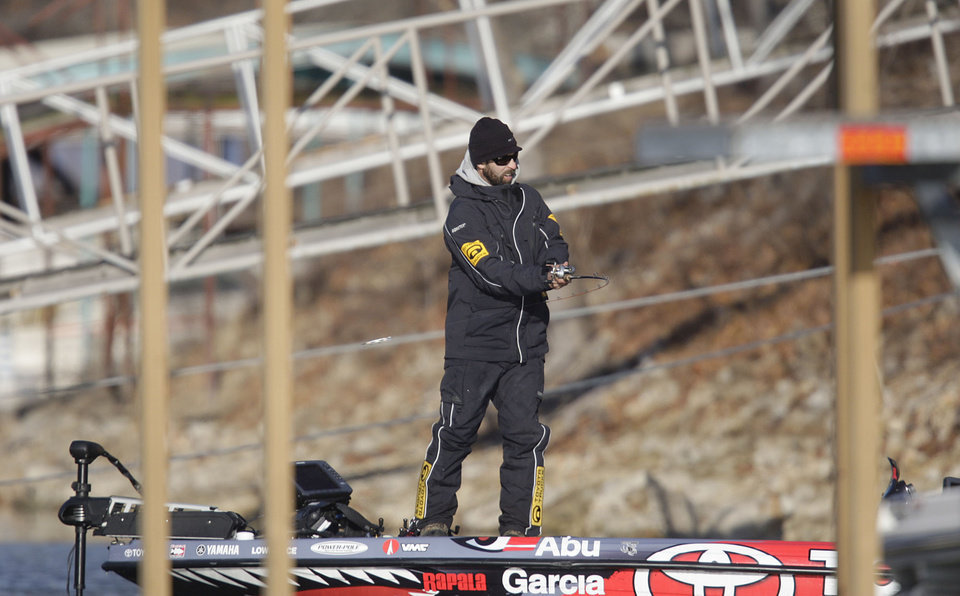 Photo - Michael Iaconelli fishes boat docks on day 2 of the Bassmaster Classic  Feb. 23, 2013. MIKE SIMONS/Tulsa World
