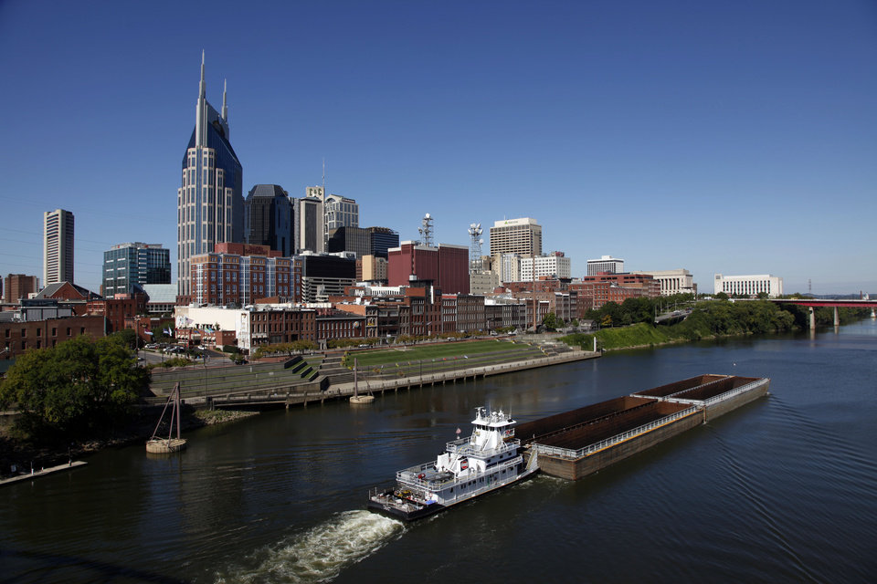 Photo - FILE -- This Sept. 27, 2011 file photo shows the Cumberland River and downtown Nashville, Tenn. The banks of the river and the bridges over it offer viewpoints for the skyline that inspired Bob Dylan to write a country album. (AP Photo/Mark Humphrey, File)