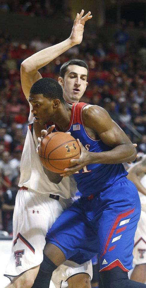 Photo - Texas Tech's Dejan Kravic defends Kansas' Joel Embiid, right during their NCAA college basketball game in Lubbock, Texas, Tuesday, Feb, 18, 2014. (AP Photo/Lubbock Avalanche-Journal, Stephen Spillman)