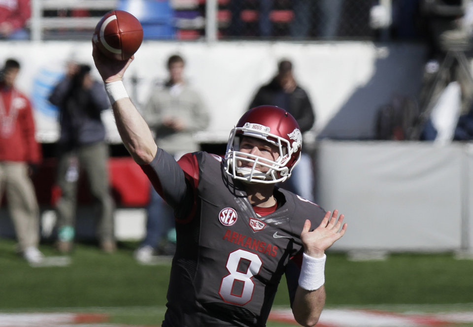 Photo -   Arkansas quarterback Tyler Wilson passes during the first half of an NCAA college football game against Mississippi in Little Rock, Ark., Saturday, Oct. 27, 2012. (AP Photo/Danny Johnston)