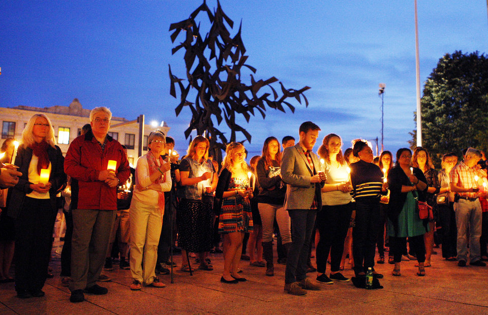 Photo -   Boston University students and faculty members hold a candlelight vigil on Marsh Plaza at Boston University, Saturday, May 12, 2012, for three students studying in New Zealand who were killed when their minivan crashed during a weekend trip. At least five other students were injured in the accident, including one who was in critical condition. Boston University spokesman Colin Riley said those killed in the accident were Daniela Lekhno, 20, of Manalapan, N.J.; Austin Brashears, 21, of Huntington Beach, Calif.; and Roch Jauberty, 21, whose parents live in Paris. (AP Photo/Bizuayehu Tesfaye)