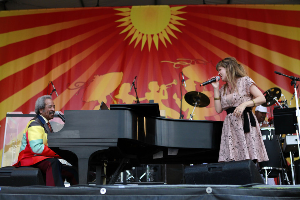 Photo -   Theresa Andersson and Allen Toussaint perfrom a duet at the New Orleans Jazz and Heritage Festival in New Orleans, Saturday, May 5, 2012. (AP Photo/Gerald Herbert)