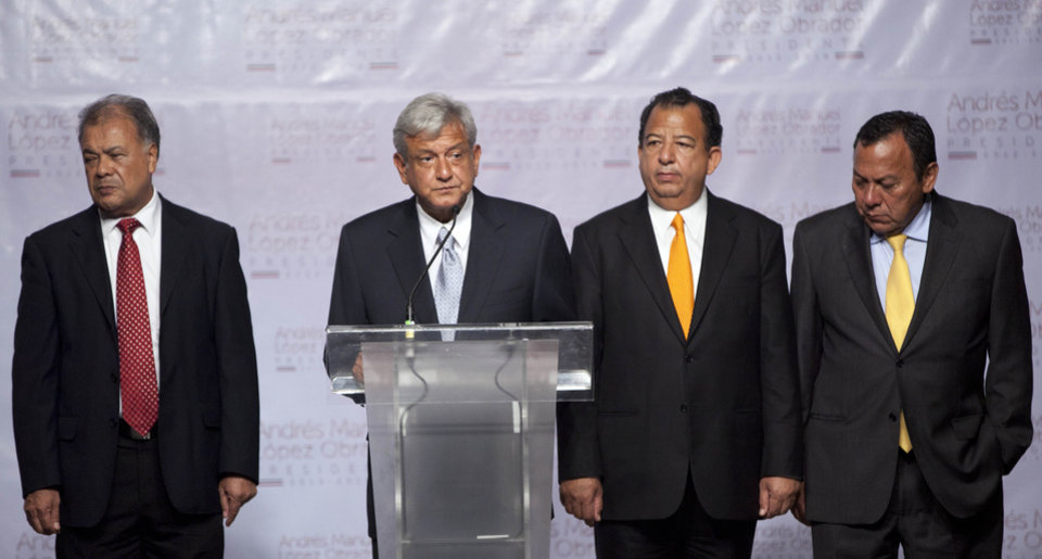 "Photo -   Surrounded by unidentified members of his coalition, Mexican presidential candidate Andres Manuel Lopez Obrador of the Democratic Revolution Party (PRD), second from left, speaks during a press conference at a hotel in Mexico City, Monday, July 2, 2012. After official results showed Enrique Pena Nieto of the Institutional Revolutionary Party (PRI) winning 38 per cent of the vote with more than 92 per cent of the votes counted, Lopez Obrador has not conceded Sunday's elections, telling his supporters Monday evening that, ""We can't accept a fraudulent result,"" a reference to his allegations that Pena Nieto exceeded campaign spending limits, bought votes in some states and benefited from favorable coverage in Mexico's semi-monopolized television industry.(AP Photo/Alexandre Meneghini)"