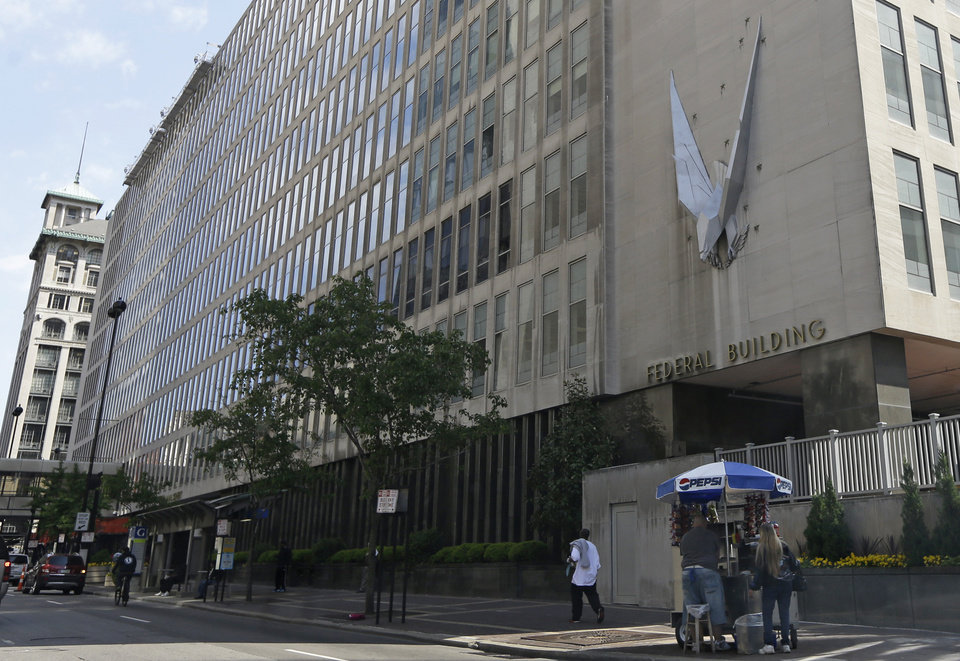 Photo - The John Weld Peck Federal Building, shown Tuesday, May 14, 2013, in Cincinnati, houses the main offices for the Internal Revenue Service in the city. The IRS apologized Friday for what it acknowledged was